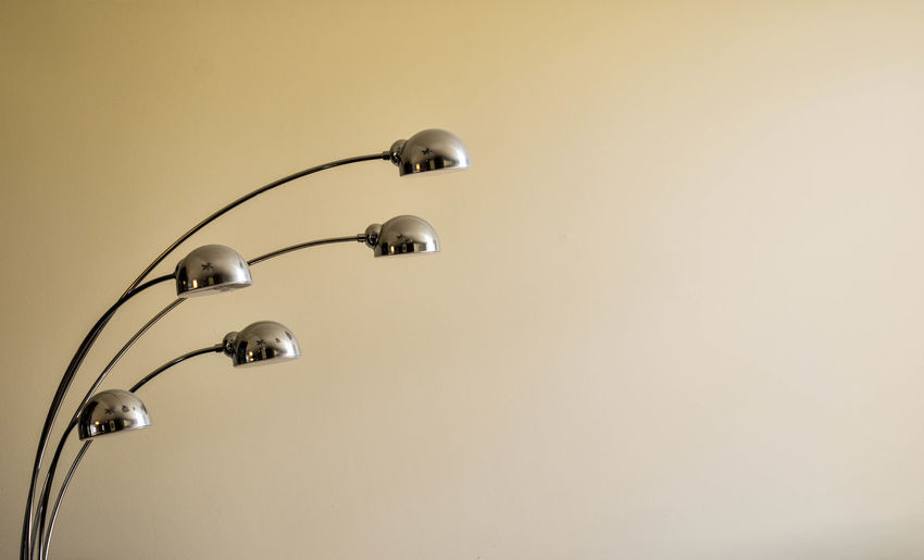 Close-up of electric lamp against wall