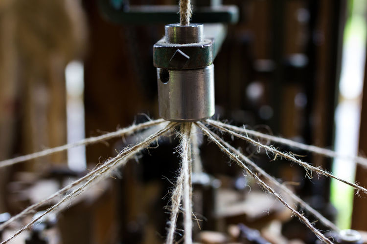 Making ropes the old way. Close-up Craftsmanship  Detail Focus On Foreground Handmade Machine Part Making Rope Metallic No People Old Part Of Rod Rope Ropemaker Selective Focus Spinning Strength Technical Detail Technology