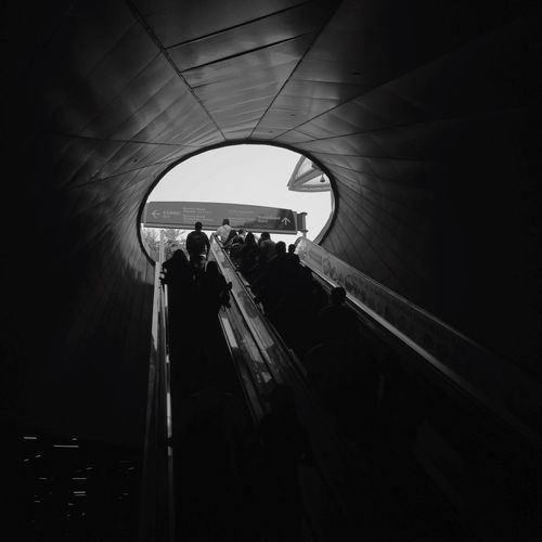 Silhouette people in tunnel