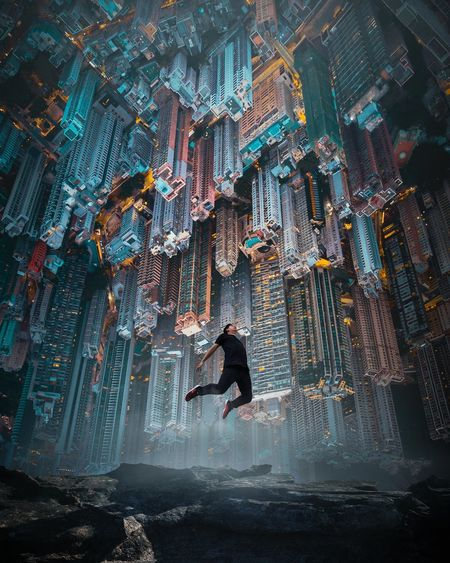 Digital composite image of man jumping on mountain against cityscape at night