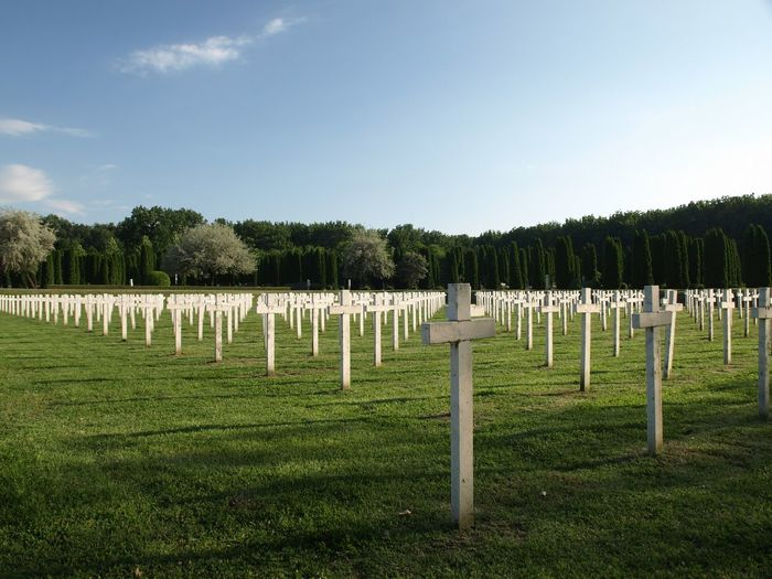 View of cemetery on field against sky
