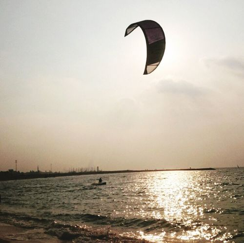Adventure Sport Sea Nature Sunset Extreme Sports Water Parachute Outdoors Vacations One Person Sky Scenics Day Beauty In Nature Clear Sky Paragliding People Dubai Beach