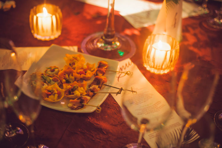 Canapés Burning Candle Celebration Close-up Dinner Eating Utensil Fire Fire - Natural Phenomenon Flame Food Food And Drink Freshness Glass Glowing High Angle View Illuminated Indoors  Meal No People Plate Ready-to-eat Selective Focus Table Tea Light