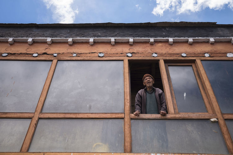 Himachal Pradesh, India Key Monastery Spiti Valley India Waiting Architecture Building Exterior Built Structure Cloud - Sky Day Old Age Old Age Home Old Age People One Person Outdoors People Portrait Real People Roof Sky Smiling Spirituality