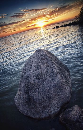 Big boulder. Boulder Lakeside Lake Winnipeg Sunset_collection Water Clouds Howiseethings Naturesbeauty