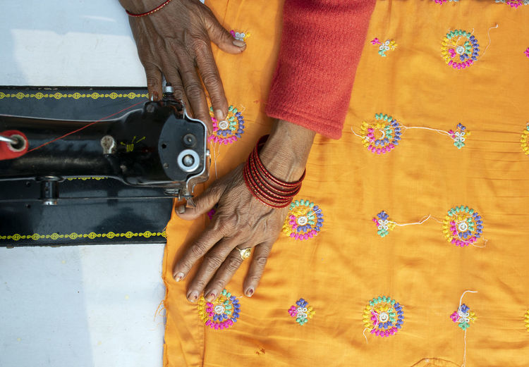 Close-up of woman working on sewing machine