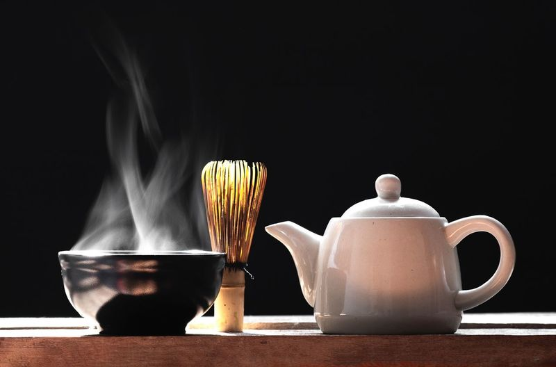 Hot matcha green tea on a black background Wallpapers Zen Smoke Hot Heat - Temperature Cup Table Indoors  Still Life No People Mug Food And Drink Tea - Hot Drink Tea Drink Burning Close-up Black Background Hot Drink Tea Cup Coffee Cup Nature