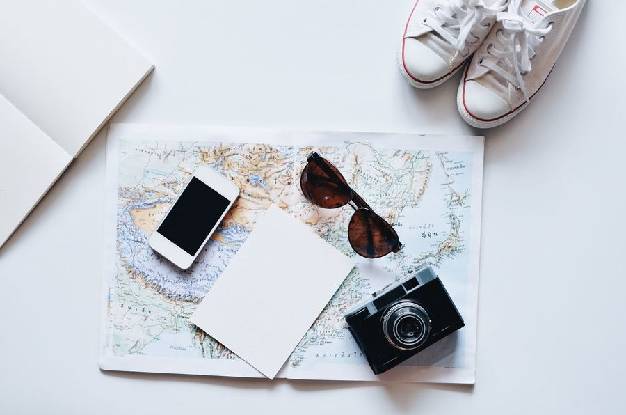 Top view of variety of objects,travel concept #maperspectives #travel Camera - Photographic Equipment Close-up Day High Angle View Indoors  No People Photography Themes Still Life Table Technology White Background Wireless Technology