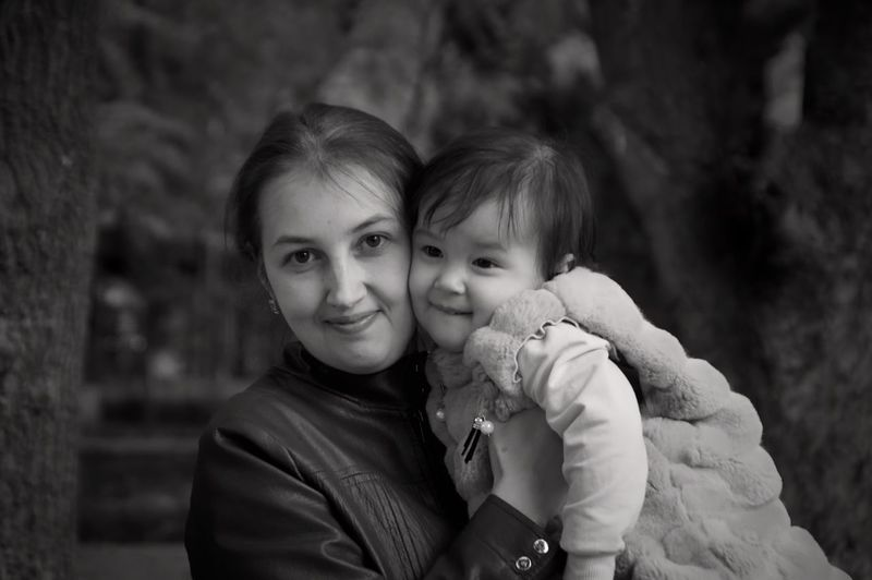 Portrait of woman with daughter
