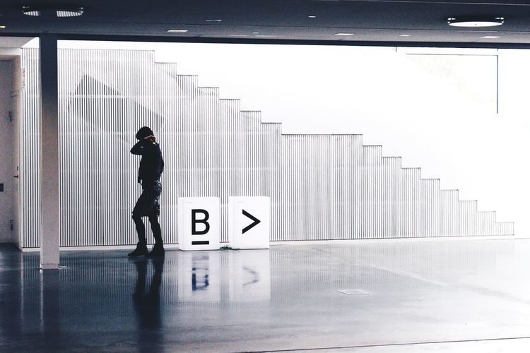 Side View Full Length Of Person Walking In Modern Building