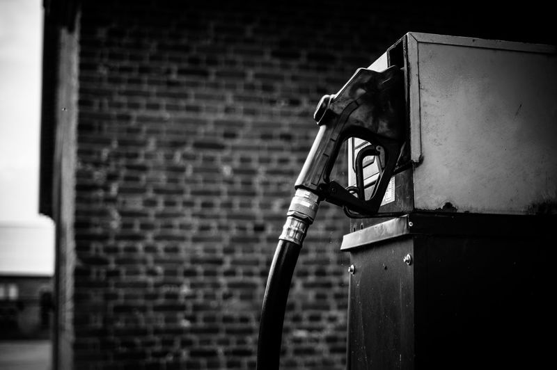 Petrol pump against brick wall