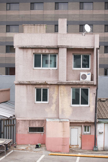 Architecture Window Built Structure Building Exterior Building No People Residential District Day Outdoors City Full Frame Construction Industry Low Angle View Wall Industry Side By Side In A Row Glass - Material Old Street Apartment
