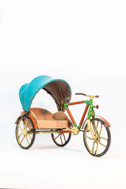 Tricycle still use as taxi in short way. Background; Cartage; Colorful; Culture; Cycling; Day Dust; Leisure; Lifestyle; Manpower; Model; No People Outdoors; Promenade; Rickshaw; Ride; Sightseeing; Slow; Steel; Tourist; Transportation Tricycle; Vintage; Wheel; White Background