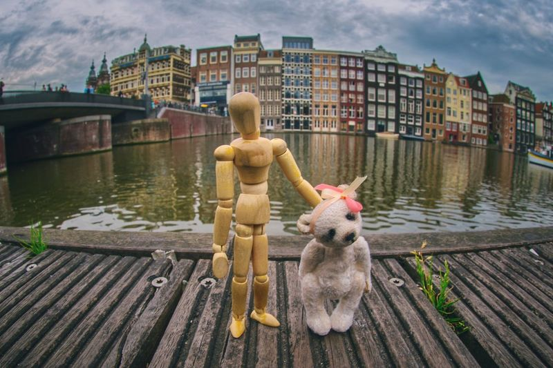 A walk in Amsterdam Amsterdam Woodyforest Built Structure Architecture Water Building Exterior City Day No People River Cloud - Sky Animal Themes Art And Craft Outdoors Representation The Traveler - 2019 EyeEm Awards