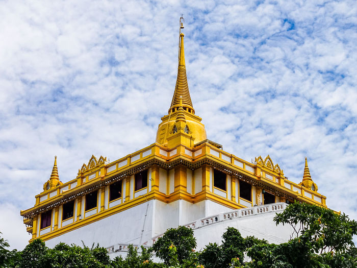 Golden Mountain Built Structure Architecture Building Exterior Belief Religion Place Of Worship Building Sky Spirituality Cloud - Sky Gold Colored Plant Low Angle View Tree Travel Destinations Day No People Spire  Outdoors Ornate Thailand Culture Temple