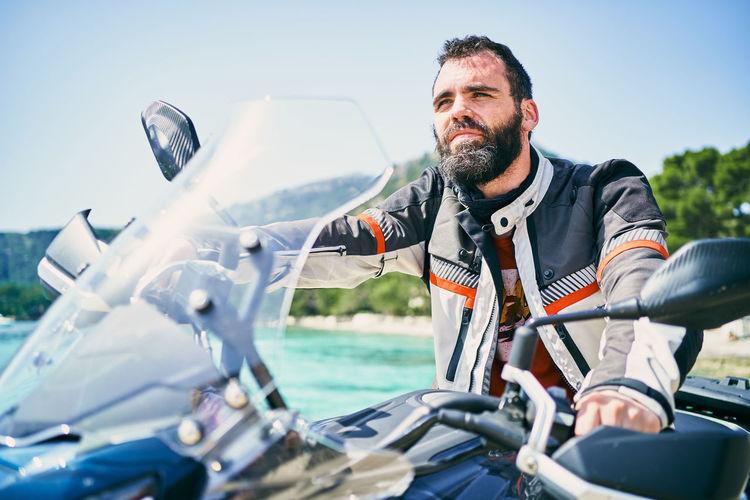 Full length of man sitting on boat against sky