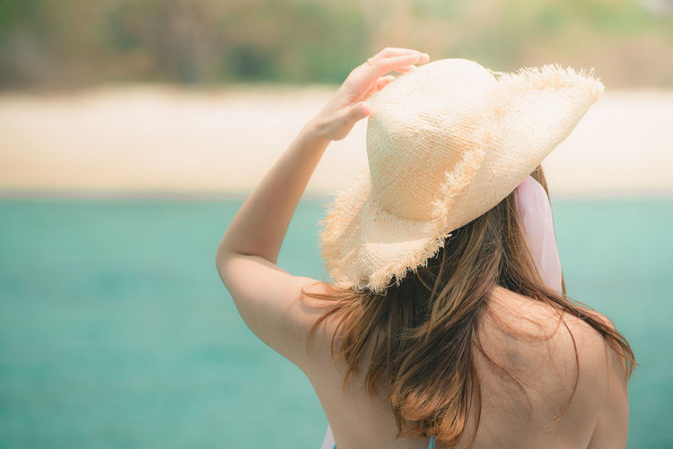 One Person Focus On Foreground Real People Women Hair Rear View Leisure Activity Hat Hairstyle Adult Lifestyles Day Clothing Long Hair Headshot Nature Water Standing Young Adult Outdoors Human Hair Obscured Face Arms Raised Sun Tanning Sea Ocean Hat Relaxing Freedom Tourism Tourist Happiness Sunbeam Travel Beach Funny Summer Alone Happy Holiday Hair Back Beautiful Girl Island Boat Ship Morning Horizontal Freshness Thailand Hot Cool Refreshment Caucasian Sand Swimming Bikini Sport