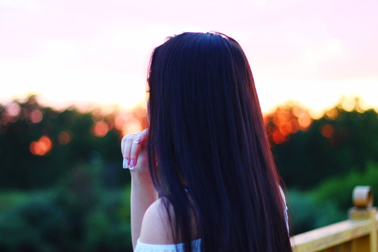 real people, one person, rear view, focus on foreground, long hair, outdoors, leisure activity, lifestyles, headshot, women, sunset, nature, day, sky, close-up, young adult, adult, people