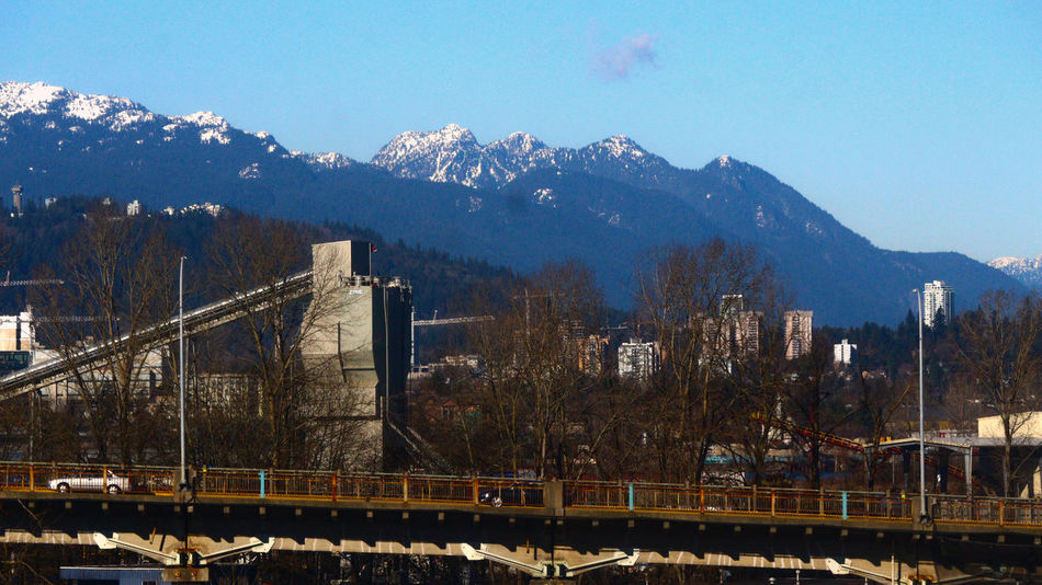 Mill in Port Moody B.C. witm mountains in background. Port Moody Canada Mill Mountain Sky Tree Outdoors Day Winter No People
