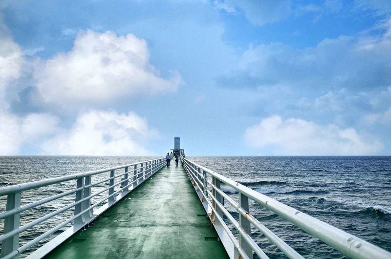 Very long bridge to the lighthouse Sky Cloud - Sky The Way Forward Direction Railing Water Nature Bridge Architecture Connection Day Diminishing Perspective Sea Built Structure Scenics - Nature Beauty In Nature Transportation Tranquility Bridge - Man Made Structure Outdoors