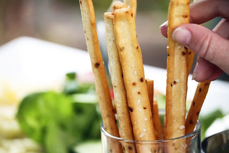 Breadsticks with dinner. Snack Appetizer Background Baked Bakery Bread Breadsticks Close-up Closeup Delicious Eat Food Food And Drink Fresh Freshness Grissini Hand Healthy Eating Italian Lifestyles Nutrition Snack Sticks Table Tasty