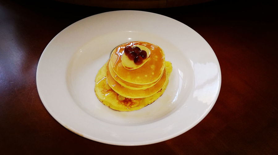 High Angle View Of Pancakes Served On Table