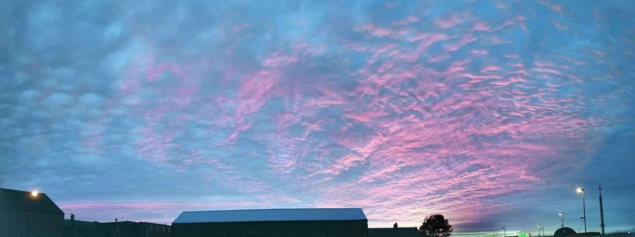 sky, building exterior, architecture, built structure, cloud - sky, nature, low angle view, sunset, no people, building, beauty in nature, outdoors, pink color, tree, city, dusk, plant, day, scenics - nature, purple, romantic sky