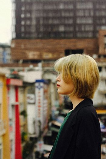 Portrait of woman looking at city