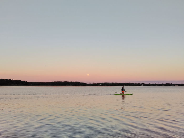 Adventure Beauty In Nature Blue Dusk Gradient Idyllic Lake Lake View Leisure Activity Nature Outdoors Paddling Purple Relaxing Rippled Scenics Sky Stand Up Paddling Stillness Sunset Sup Tranquil Scene Tranquility Unrecognizable Person Water