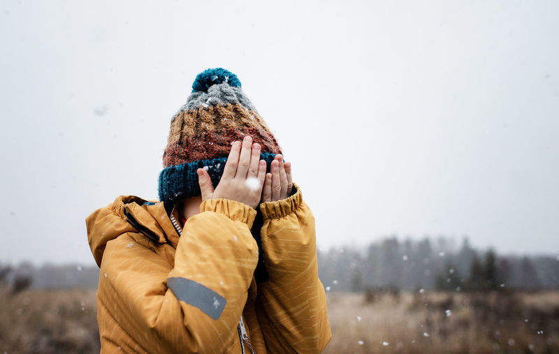 Full length of man holding bird on snow