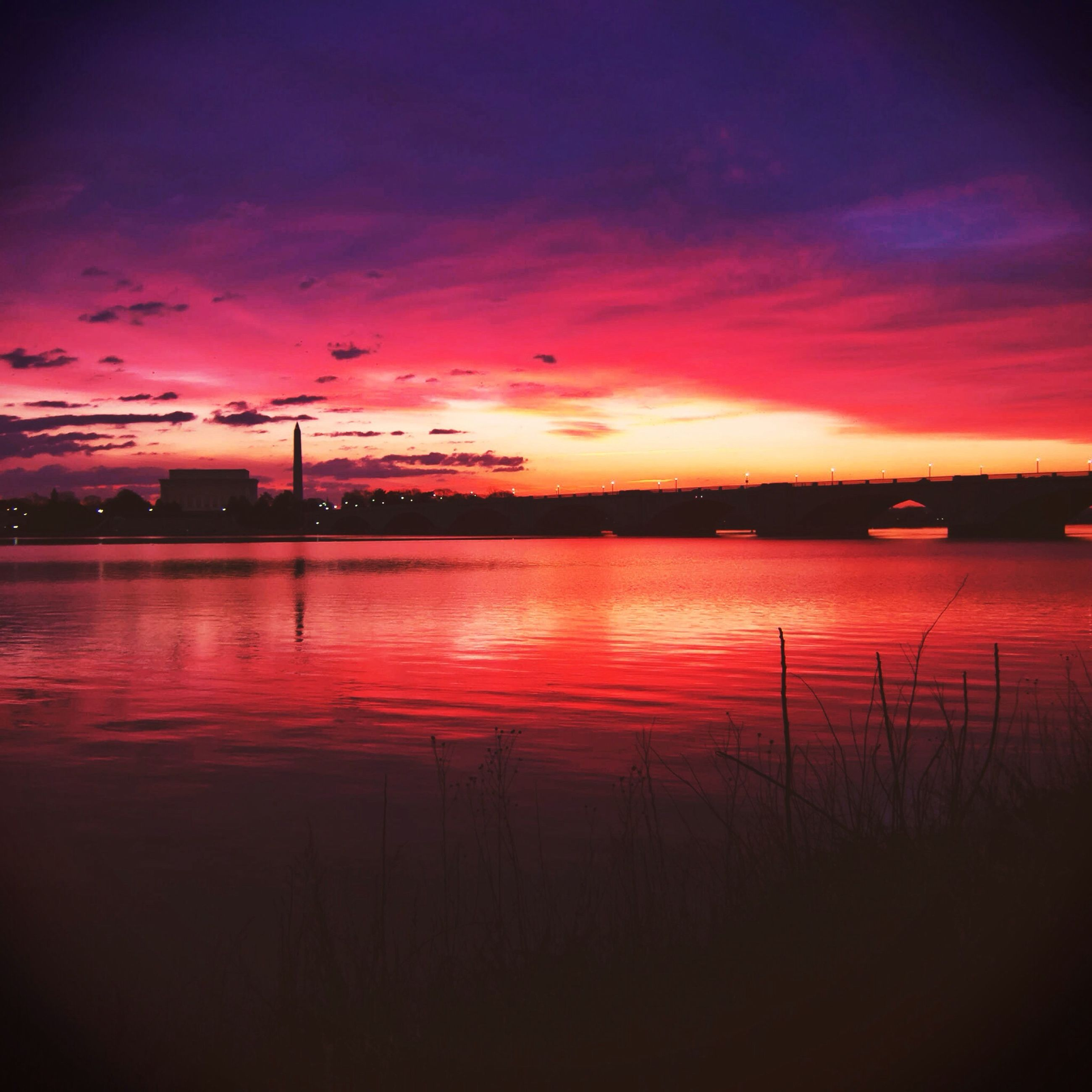 sunset, water, sky, orange color, silhouette, scenics, tranquility, tranquil scene, beauty in nature, reflection, lake, idyllic, cloud - sky, nature, river, dusk, red, dramatic sky, cloud, calm