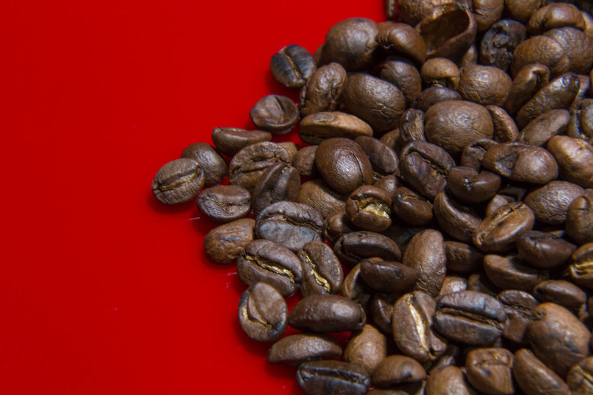The Roasted Coffee Beans red background macro close up image for coffee background. Roasted Coffee Beans Coffee Beans Baker Coffee Beans Roasted Close-up Coffee Bean Coffee Beans Coffee Beans For Sale Coffee Beans Roaster Food Food And Drink Freshness Healthy Eating Indoors  Large Group Of Objects No People Raw Coffee Bean Red Roasted Roasted Coffee Roasted Coffee Bean Studio Shot