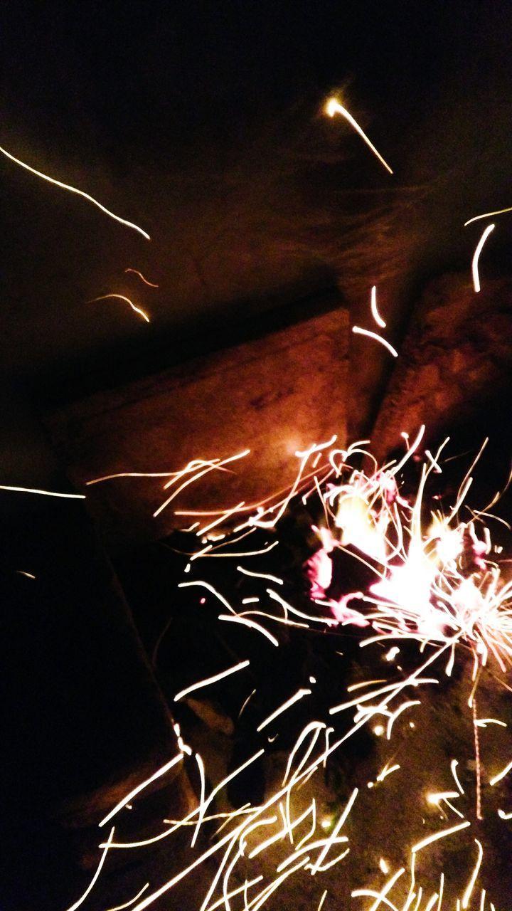 night, illuminated, glowing, long exposure, burning, celebration, motion, no people, indoors, sparkler, close-up