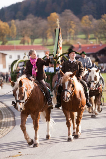 Hundham, Bavaria - November 4, 2017: Every year on the 1st Saturday in November the Idyllic Horse procession, named Leonhardi in the Bavarian Hundham takes place in memory of Patron St. Leonhard. In traditional clothing and decorated horse-drawn carriages horses and riders move to the church of St. Leonhard Bavaria Church Hundham Leonhard Ride Leonhardi Leonhardiritt Patron St.Leonhard St.Leonard Traditional Clothing Carriage Day Decorated Dirndl Domestic Animals Horse Horse Procession Horse-drawn Vehicle Idyllic Mammal Men Outdoors People Real People Riders Tourism