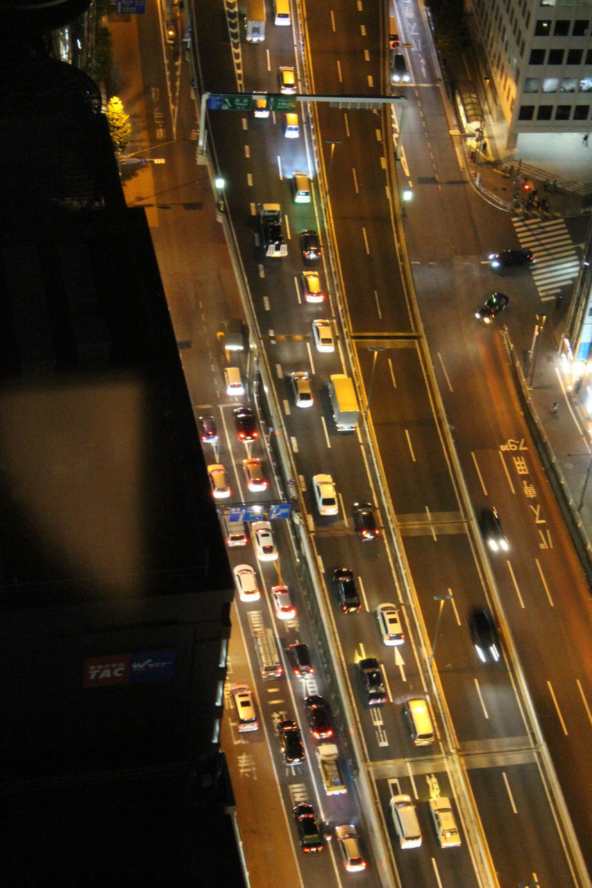 HIGH ANGLE VIEW OF ROAD IN CITY AT NIGHT