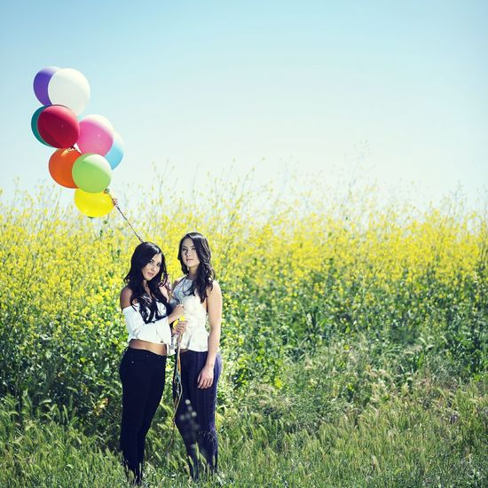 Because balloons :). Balloons Sisters Fields Colorful Sibling Love First Eyeem Photo Familyportrait Iloveeyeem