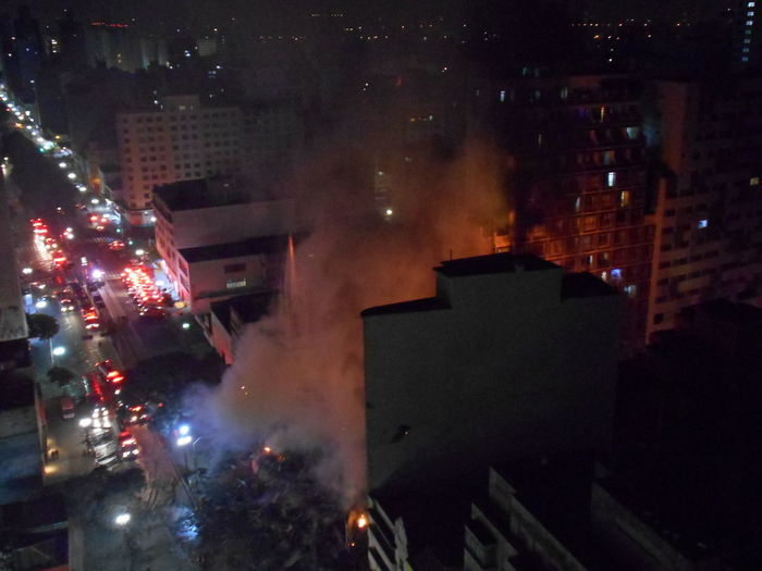 Building Collapse: Inner City Calamity in downtown São Paulo at Largo do Paissandú; 3 am May 1, 2018. The abandoned former Federal Police steel and glass skyscraper, which had been invaded by street people, imploded this early morning and the neighboring building has caught on fire as well. This photo taken between 4 am to 5 am, May 1, 2018 at Largo do Paissandú. Current Events Destruction Destruction Can Be Beautiful Largo Do Paissandu May 1, 2018 Night Photography Susan A. Case Sabir The Week on EyeEm Unretouched Photography About 4 Am Building Collapse Building Fire Building Implosion Burning Building Controlled Chaos Dangerous Situation Downtown São Paulo Helicopters Overhead High Angle View Responsiveness Smoke - Physical Structure Unexpected Event Urban Photography Urban Strife