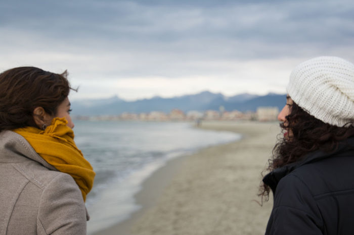Sisters Adult Adults Only Beach Coastline Cold Temperature Day Italy Leisure Activity Nature Only Women Outdoors People Sea Sisters Smiling Togetherness Tourism Travel Two People Vacations Warm Clothing Winter Women Young Adult Young Women