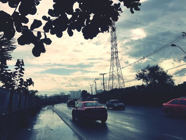 Car on the road Motor Vehicle Sky Car Tree Transportation Mode Of Transportation The Street Photographer - 2018 EyeEm Awards Outdoors Building Exterior Built Structure Architecture No People Cloud - Sky Road City Plant Land Vehicle Nature Street Day Direction