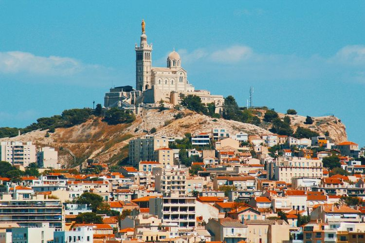 Marseille mon amour City City Life Cityscape Provence South Of France Marseille EyeEm Gallery EyeEm Selects Architecture Building Exterior Built Structure Sky Cloud - Sky Day Cityscape City Community No People Spirituality Outdoors Mountain