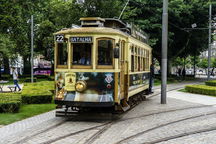 Streetphotography City Tramway City Life Tramway Rail Mode Of Transportation Transportation Land Vehicle Public Transportation Cable Car Railroad Track Rail Transportation Day Track Incidental People Plant Outdoors Architecture Tree Train Nature Green Color Grass