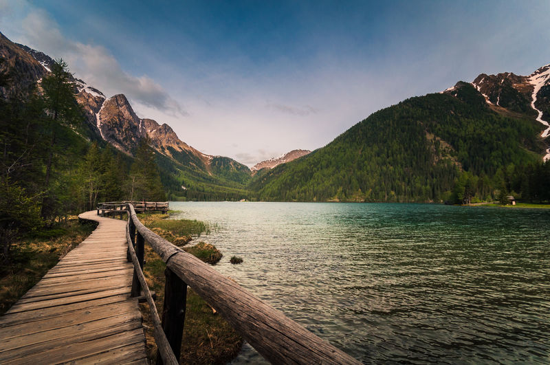 Mountainlake My Best Photo Water Mountain Beauty In Nature Scenics - Nature Wood - Material Tranquility Sky Tranquil Scene Nature Lake Mountain Range Idyllic Non-urban Scene Pier The Way Forward Day No People Cloud - Sky Direction Outdoors Wood Wood Paneling Südtirol Alto Adige