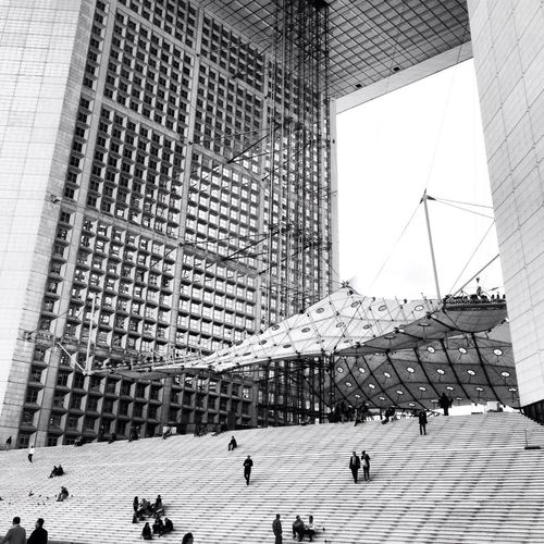 People On Steps Of Grande Arche Building