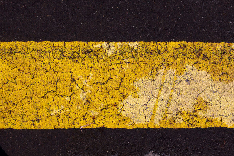 Asphalt Backgrounds City Close-up Concrete Day Dividing Line Full Frame High Angle View Marking No People Outdoors Pattern Road Road Marking Rough Sign Street Symbol Textured  Textured Effect Transportation Yellow