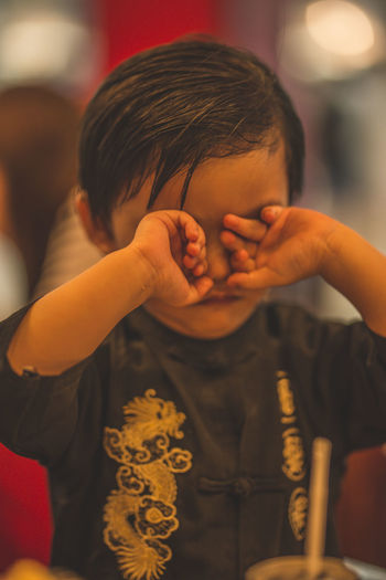 Sleepy eyes Eyeem Philippines The Week on EyeEm Boys Casual Clothing Child Childhood Close-up Focus On Foreground Front View Hand Headshot Indoors  Innocence Leisure Activity Lifestyles Males  Men One Person Portrait Real People