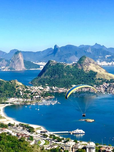 Paraglider flying over Niterói-RJ. Paragliding Corcovado Pão De Açucar Niterói Rio De Janeiro Eyeem Fotos Collection⛵ Mountain Sky Scenics - Nature Beauty In Nature Water Day Blue Nature Mountain Range Tranquil Scene Clear Sky Landscape Environment Non-urban Scene The Mobile Photographer - 2019 EyeEm Awards