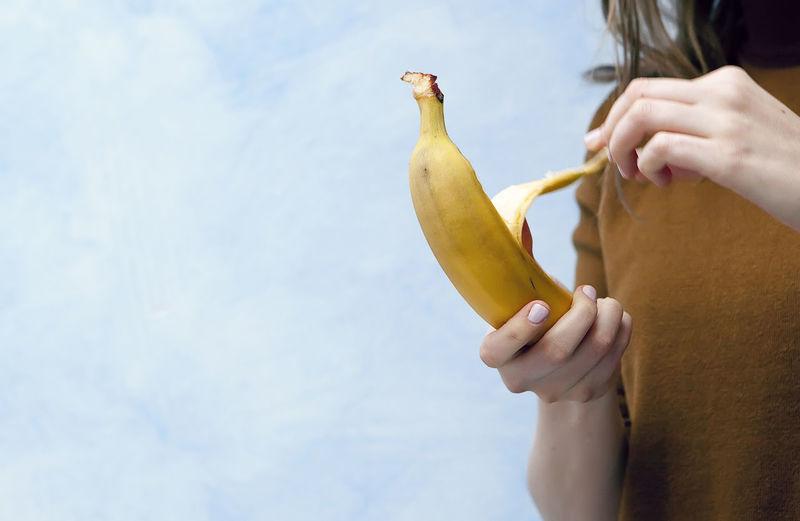 Woman Opening Banana