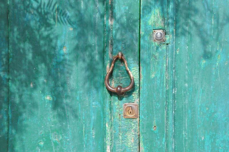 Close-up of metal knocker door
