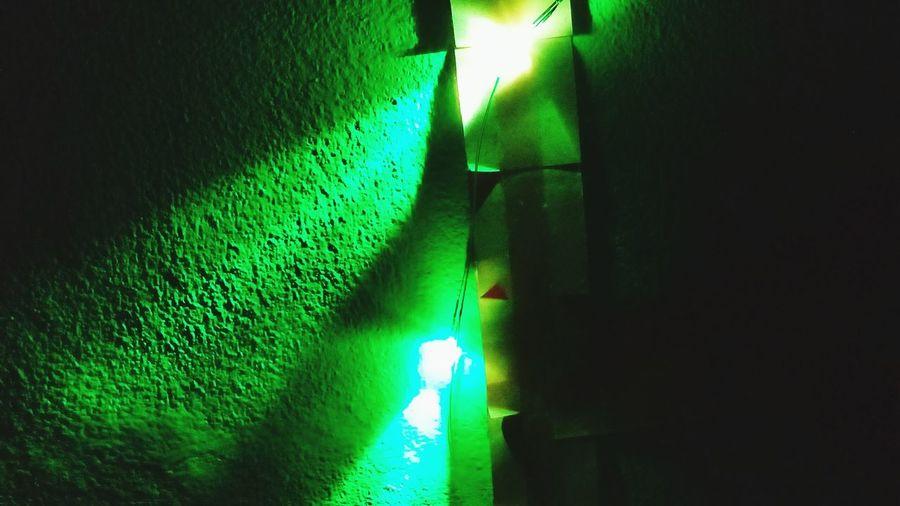 Illuminated lights on grass at night