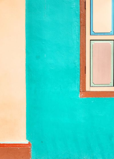 No People Architecture Multi Colored Close-up Full Frame Backgrounds Built Structure Textured  Blue Building Exterior Day Copy Space Wall - Building Feature Green Color Turquoise Colored Window Building Orange Color Pattern
